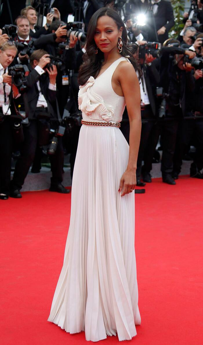 'Avatar' girl Zoe Saldana was graceful and gorgeous in a Victoria Beckham dress, Christian Louboutin shoes and Di Grisogono jewellery. <br /><br /> Seen here, the actress looks smoldering as she poses on the red carpet after her arrival for the 67th Cannes Film Festival and the screening of the 'Grace of Monaco'. (Source: Reuters)