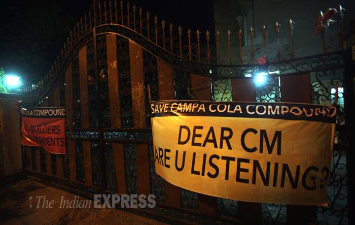 """Banners saying """"Save Campa Cola Compound"""" are seen hanging on the gates of Campa Cola in Mumbai on Thursday. (Source: Express photo by Pradip Das)"""
