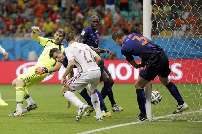 Netherlands got their third goal in a scrappy manner when Spain goal-keeper Iker Casillas failed to collect a free kick and De Virj did enough to score the third for Netherlands. (Source: AP)