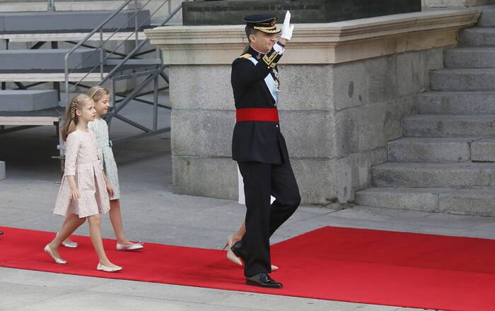 Felipe became king after his father, Juan Carlos, abdicated earlier this month following a series of scandals that led many Spaniards to question the role of the monarchy itself. <br /><br />Princess Sofia and Princess Leonor walk behind their father Spain's King Felipe VI at the the swearing-in ceremony. (Source: Reuters)