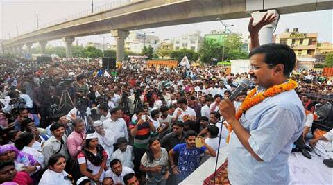 AAP Chief Arvind Kejriwal addressing a rally organised by National Capital E-Rickshaw Association at Adarsh Nagar in New Delhi on Sunday. (Source: AP)