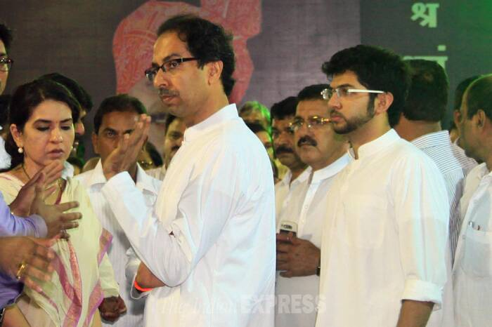 Shiv Sena chief Uddhav Thackeray seen here with his son Aditya at Munde's residence to pay respects.  (Source: Express photo by Amit Chakravarty)