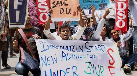 SFI activists protest against the four-year undergraduate programme (FYUP) of Delhi University in New Delhi on Thursday. (Source: PTI photo)