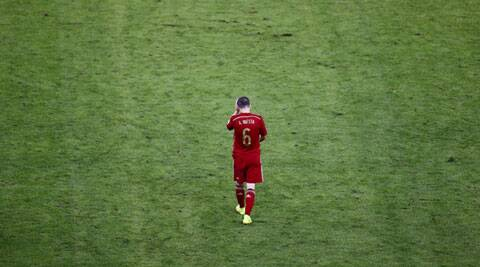 Spanish midfielder Andres Iniesta, hero of the 2010 World Cup final, walks off the field after his team's defeat in the Group B match on Wednesday. (Source: Reuters)