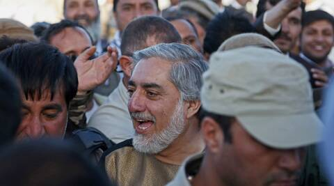 Afghanistan presidential candidate Abdullah Abdullah greets with his supporters during a campaign rally in the Paghman district of Kabul, Afghanistan. (AP)