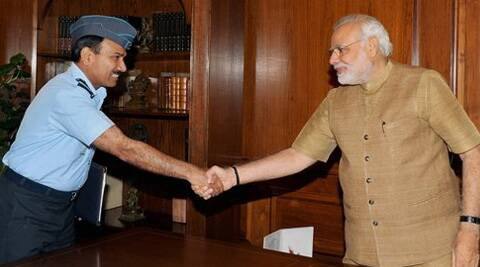 Prime Minister Narendra Modi shakes hands with Chief of the Air Staff, Air Chief Marshal Arup Raha in New Delhi on Monday. ( Source: PTI )