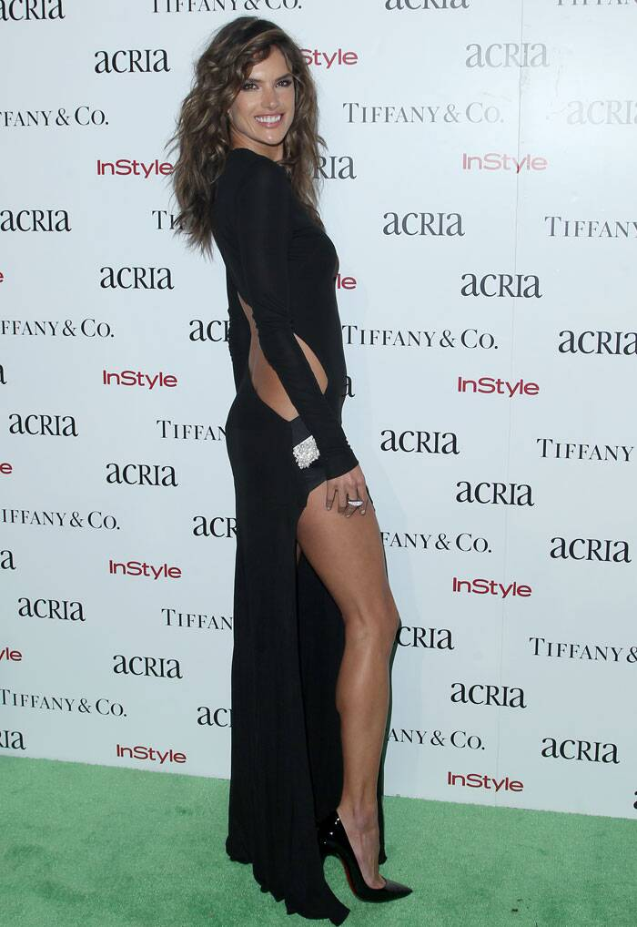 Leggy lass Alessandra Ambrosio flashed her toned pins in a black cut-out-back gown with a thigh-high slit. Black heels finished off her stylish look.  (Source: AP)