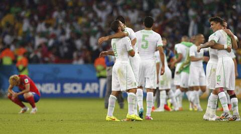 Algerian players celebrate after their 4-2 victory over South Korea (Source: AP)