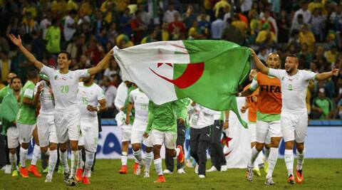 Algerian players celebrate after qualifying for the last 16. This will be their first ever knockout out stage appearance in World Cup finals. (Source: Reuters)
