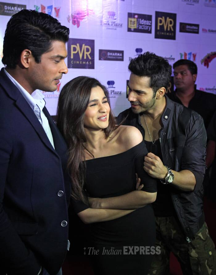 Alia Bhatt was pretty in an off shoulder black bodycon dress, while Varun was smart in his military print cargos that he teamed with black tee and jacket. Siddharth kept it formal in a suit. (Source: Express Photo by Kamleshwar Singh)