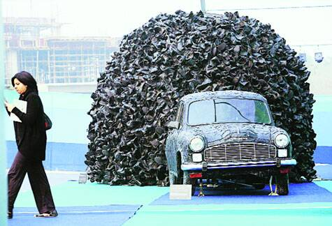 At the 2013 edition of India Art Fair, artist Mahbubur Rahman's  Replacement, a multi-media installation, had the Ambassador covered in black leather with a swarm of leather boots tumbling out of its boot.
