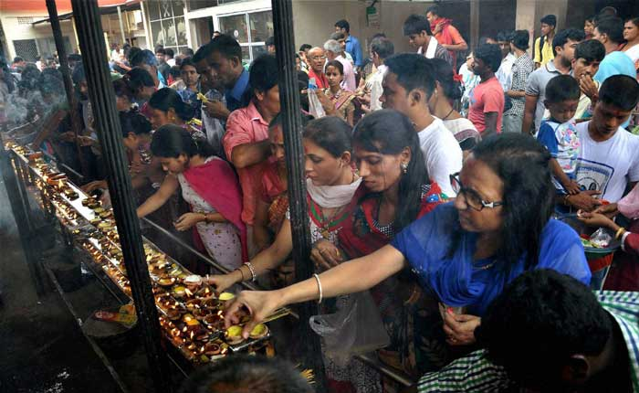Devotees light earthen lamps while offering prayers at Kamakhya Temple in Guwahati. (Source: PTI)