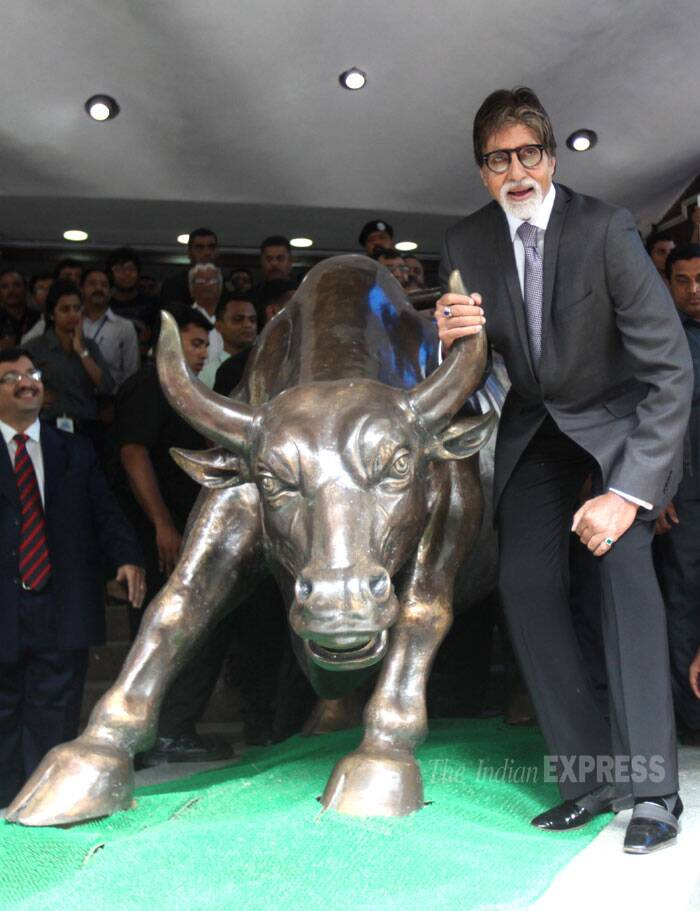 """Rung the Bell at the Bombay Stock Exchange and held the horns of the 'Bull..promotion for #YUDH..thank you BSE for this honour !"" tweeted Amitabh Bachchan. (Source: Express photo by Pradeep Kochrekar)"