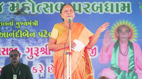 Anandi Patel addresses visitors at the annual religious fair at Parab Dham in Junagadh on Sunday.
