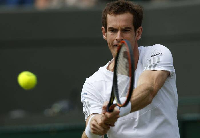 Earkier, defending champion Andy Murray beat Blaz Rola 6-1, 6-1, 6-0 to storm into the third round at Wimbledon.  (Source: AP)