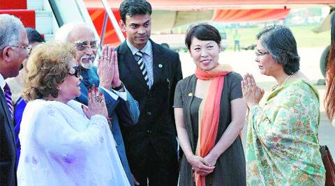 Vice-President Hamid Ansari and wife Salma Ansari greet Shaanxi province vice-governor Wang Lixia and Sharmila Kantha, wife of the Indian ambassador to China, in Xi'an, China, on Thursday. (Source: PTI)