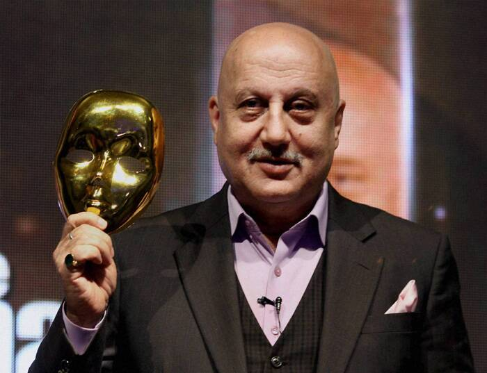 It is none other that actor-turned-host, Anupam Kher! The actor took to social networking site Twitter to share the picture of his childhood with his mother.