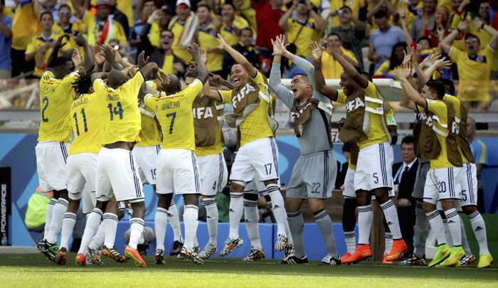 Sixteen years in the waiting: The entire Colombian team celebrates Pablo Armero's goal against Greece with a rhythmic dance. (Source: AP)