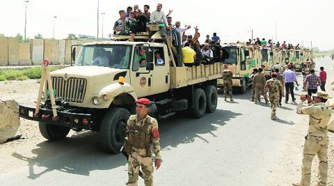Army trucks full of volunteers who have joined to fight Sunni militants in Baghdad. (Source: Reuters)