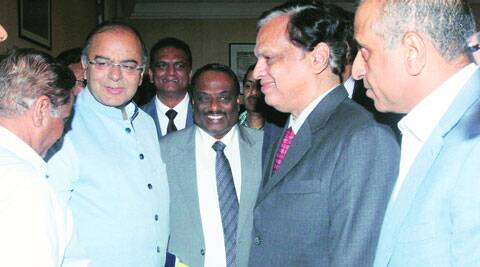 (Left to right) Finance Minister Arun Jaitley with M Rafeeque Ahmed, President, FIEO, Videocon Industries Chairman Venugopal Dhoot and Bharti Enterprises Chairman Sunil Mittal on Friday. (Source: Express photo by Prem Nath Pandey)