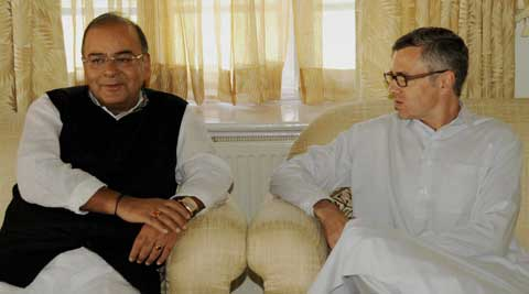 Defence Minister Arun Jaitley with Chief Minister of Jammu and Kashmir Omar Abdullah during their meeting at his residence in Srinagar. (Source: PTI)