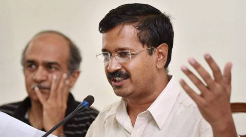 Aam Aadmi Party leader Arvind Kejriwal with party leader Prashant Bhushan during a press conference in New Delhi on Wednesday