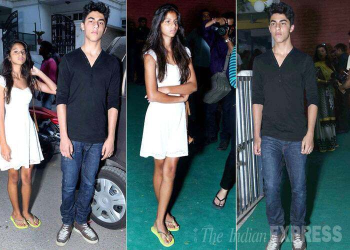 Daddy's li'l girl Suhana has grown so tall. Suhana was elegant like mom in a white dress while brother Aryan was cool in black shirt and denims. (Source: Image posted on Facebook by Gauri Khan fan page)