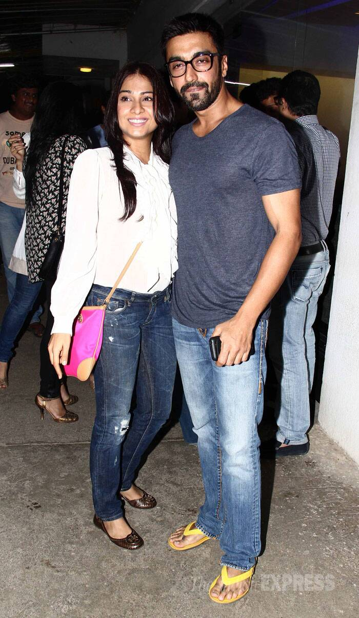 Actor Ashish Chaudhary, who is a close friend of Riteish, poses with his wife Samita Bangargi for the cameras. <br /><br /> He tweeted: Besides @Riteishd; @mohit11481,in awe of ur films bro!Soulful,FAB music,@zmilap -Unreal!! @s1dharthM @shraddhakapoor just too good! (Source: Varinder Chawla)