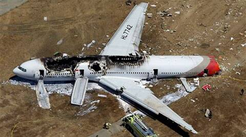 In this July 6, 2013 aerial file photo, the wreckage of Asiana Flight 214 lies on the ground after it crashed at the San Francisco International Airport in San Francisco. Source: AP