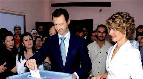 Syrian President Bashar Assad casts his vote in Damascus, Syria on Tuesday. ( Source: AP )