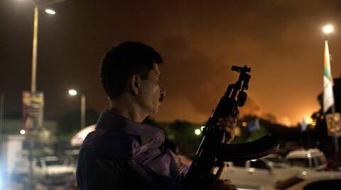 A Pakistani soldier takes position at Jinnah International Airport where security forces are fighting with gunmen. (Source: AP photo)