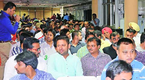During the open auction on Saturday. (Express photo by Jasbir Malhi)