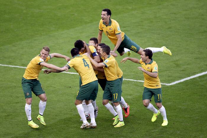 The Socceroos  celebrate their side's second goal during the 54th minute of the match. (Source: AP)