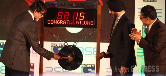 Bollywood megastar Amitabh Bachchan was spotted ringing the bell at the Bombay Stock Exchange as part of his promotional activity for the much awaited TV series 'Yudh' on Tuesday in Mumbai. (Source: Express photo by Pradeep Kochrekar)