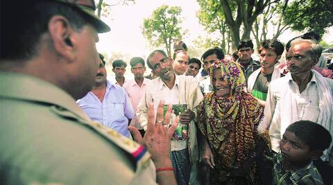 A man claims that his wife was murdered but police refused to file an FIR, at Katra Sadatganj village, Monday. Source: PRAVEEN KHANNA