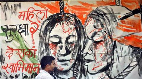In the wake of recent rape case in Badaun, an artist draws a painting raising issues of women safety, in Moradabad on Sunday. (Source: PTI)