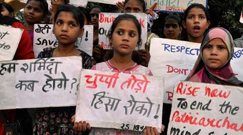 Girls take part in a protest against two dalit teenaged sisters who were hanged after being allegedly gangraped in Badaun district. (Source: PTI)