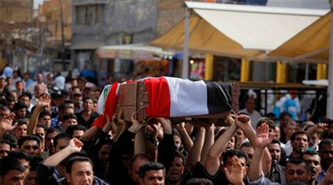 In this file photo mourners chant slogans against the al-Qaida breakaway group Islamic State of Iraq and the Levant (ISIL), while carrying a coffin of Ahmed Marzouk an Iraqi officer who was killed in a fake checkpoint in city of Najaf on May 16, 2014.
