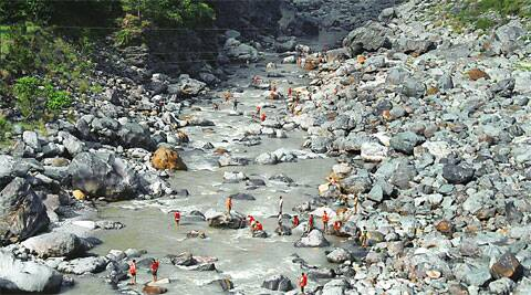 Sluice gates of the Larji hydel project were closed Saturday to allow a search along a 3-km stretch of the Beas.    (Lalit Kumar)