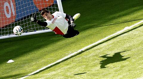 Belgium's Thibaut Courtois jumps during a training session in Belo Horizonte (Source: Reuters)