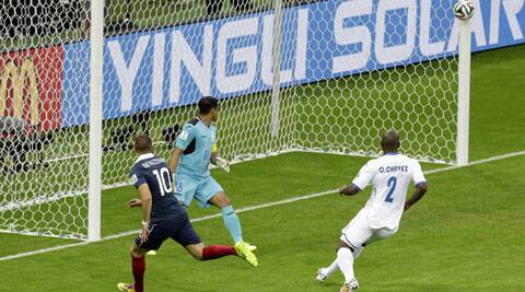 France's Karim Benzema, left, shoots the ball against the goalpost before Honduras' goalkeeper Noel Valladares scores an own goal during the group E World Cup soccer match between France and Honduras (Source: AP)