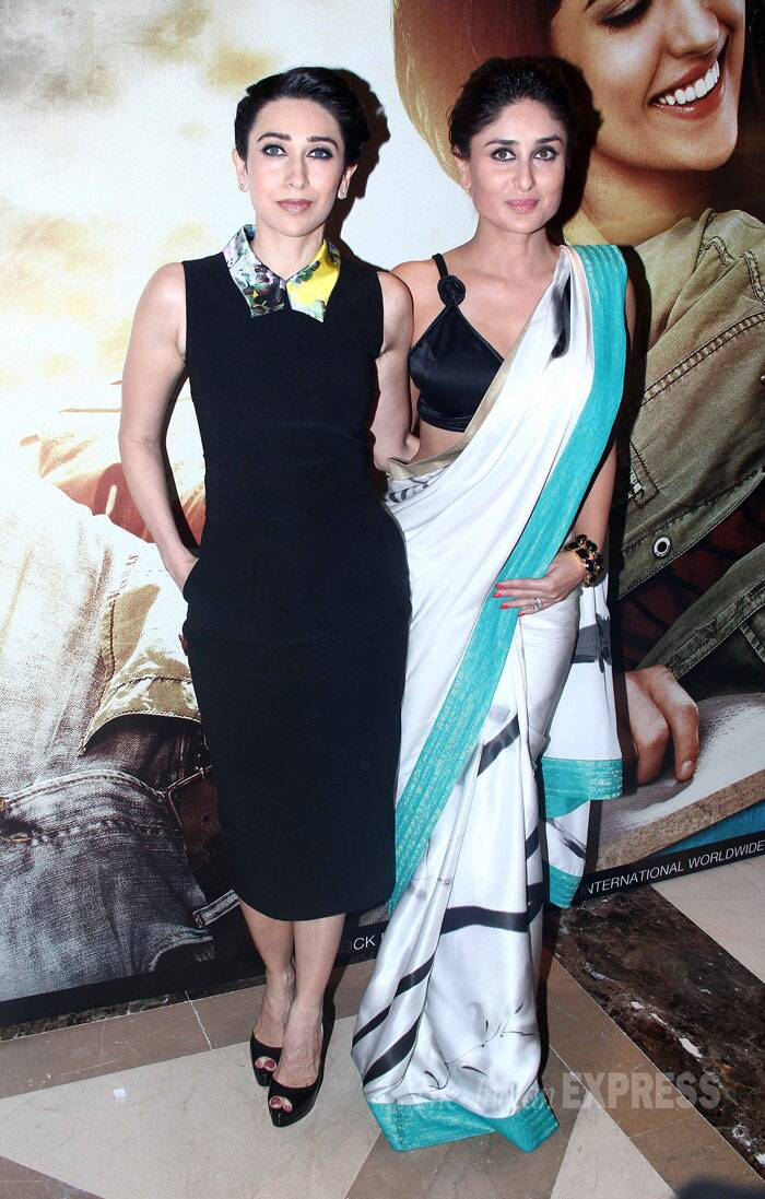 Sisters Karisma and Kareena Kapoor went for contrasting looks at a film's music launch. Karisma was chic in a Preen collared dress while Kareena went the desi route in a Satya Paul sari.