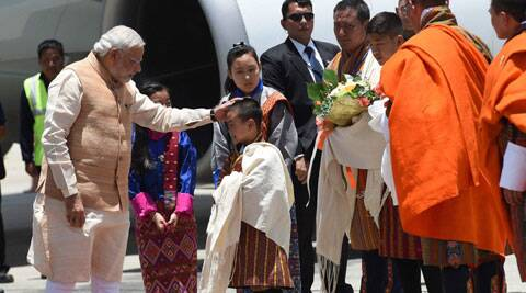 Prime Minister Narendra Modi being welcomed at Paro International Airport in Bhutan on Sunday. (Source: PTI)
