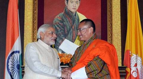 Prime Minister Narendra Modi with his Bhutanese counterpart Tshering Tobgay at a meeting in Thimphu. (Source: PTI)