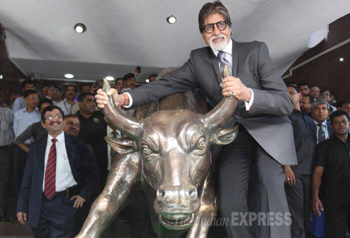 Amitabh Bachchan looked dapper in a black suit. (Source: Express photo by Pradeep Kochrekar)
