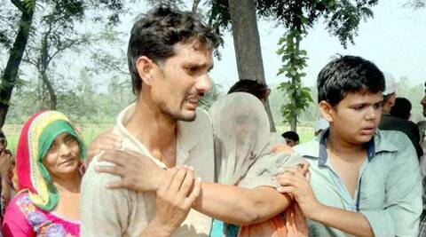 Crying family members of Om Veer Singh, a former Army man and local BJP leader who was shot dead in his village, Mirapur, in Muzaffarnagar. (Source: PTI)