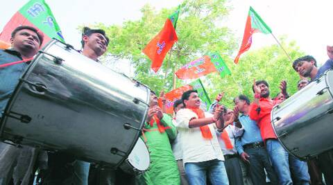 BJP workers celebrate after the announcement in Ahmedabad on Thursday. (Source: Express photo by Javed Raja)