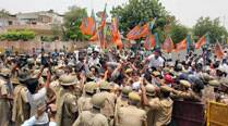 Police lathicharge BJP's youth wing activists during protest over law and order situation inUP