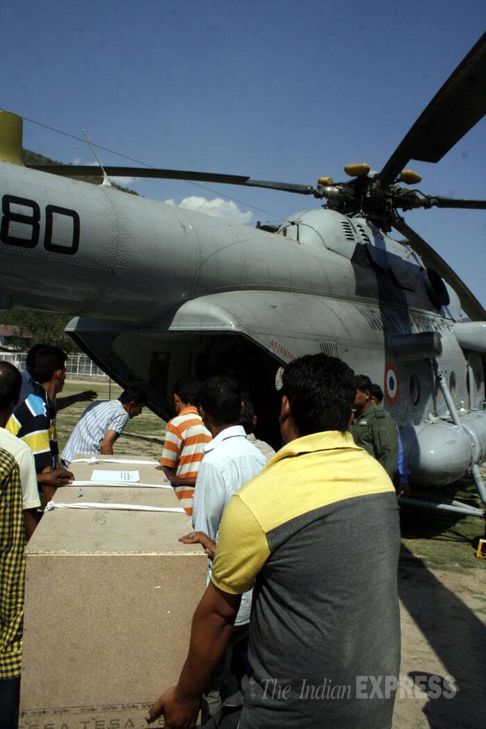 Bodies of five students including three girls and a boy were recovered on Monday by the National Disaster Response Force (NDRF) teams.<br /><br /> The body of one of the engineering students who was swept away in the Beas river, is loaded on to an IAF chopper  in Mandi on Tuesday. (Source: Express photo by Lalit Kumar)