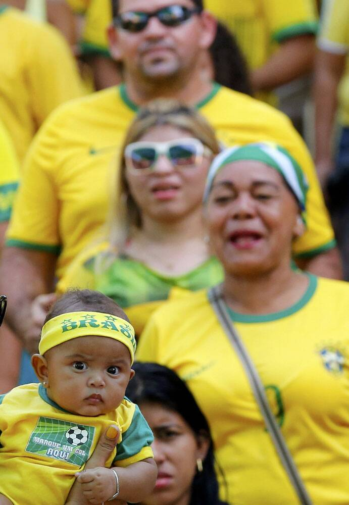 Early Starter: A little Brazilian fan is seen at the stadium during the clash against Mexico. (Source: Reuters)